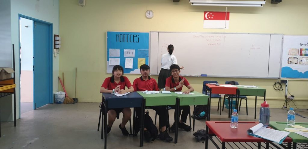 All smiles as the Secondary 3 team prepare for their Set-Text debate on the text, Fahrenheit 451