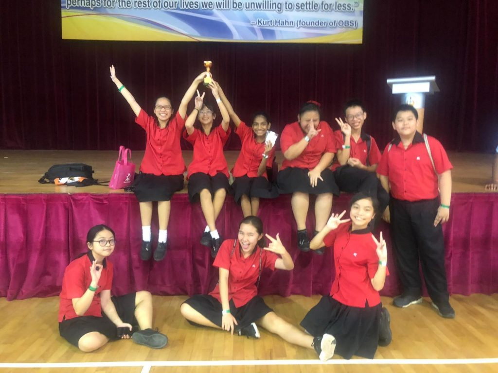 Secondary 1 Choral Reading team celebrating their Bronze award at Woodlands Ring Secondary School